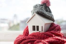 cozy miniature house wrapped in a scarf, wearing a stocking cap