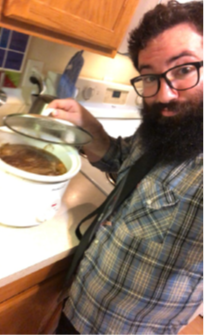 Yos Shallman showing off his crockpot